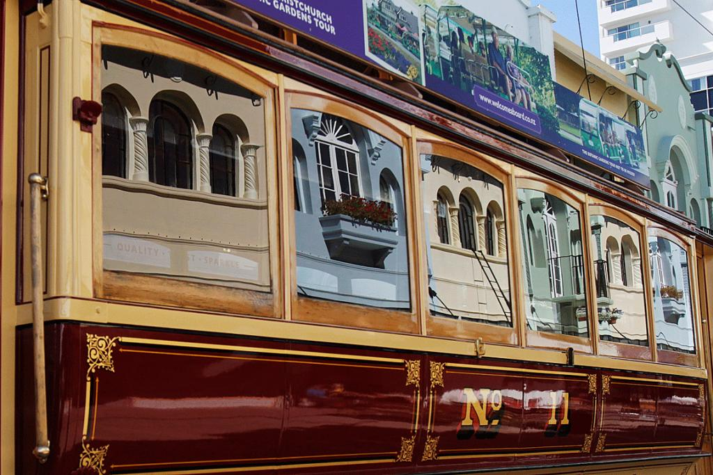 TIME FOR REFLECTION: New Regent St's colourful building facades are captured in the windows of the tram.