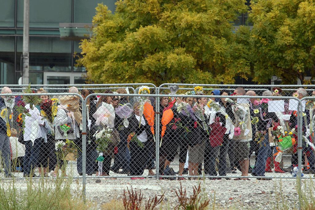 LASTING SORROW: Fences on the former CTV site are filled with flowers and tributes to those lost in the February 2011 earthquake.