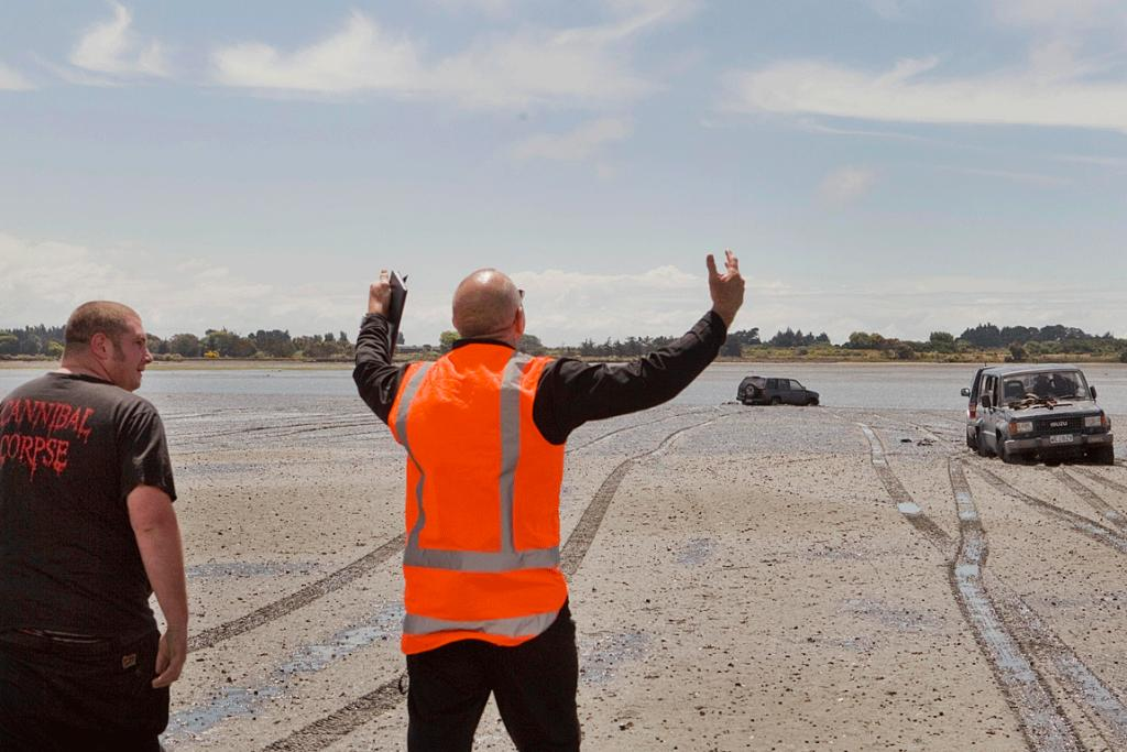 Lined up: Environment Canterbury resource management officer, Tim Ashton, centre, reacts after four-wheel-drivers got stuck trying to pull another vehicle from the Avon Heathcote Estuary.