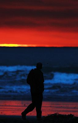 WARM GLOW: Sunrise from the mouth of the Waimakariri River heralds warmer temperatures with northwesterly winds.