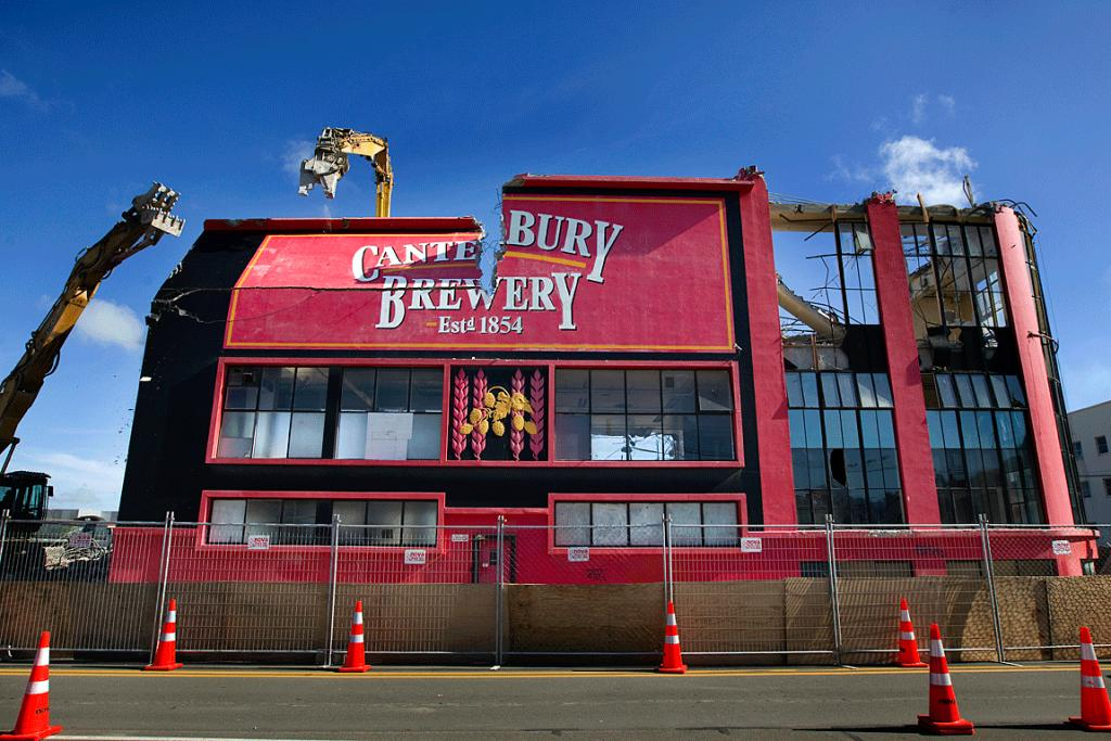 DRY TAPS: Machinery tears down the Canterbury Brewery's sign during the final stages of the building's demolition.