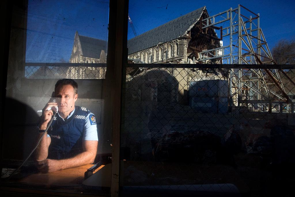 CHANGING LANDSCAPE: Police sergeant Greg Hume, officer in charge of the police kiosk in Cathedral Square, with the view of the Christ Church Cathedral from his office.