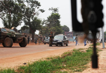 French soldiers take positions along a road during a daytime patrol in Bangui on Thursday.