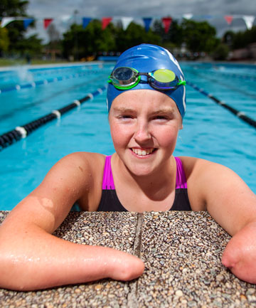 GOLDEN GIRL: Cambridge's Nikita Howarth returned from the world swimming championships in Canada with gold and bronze medals.