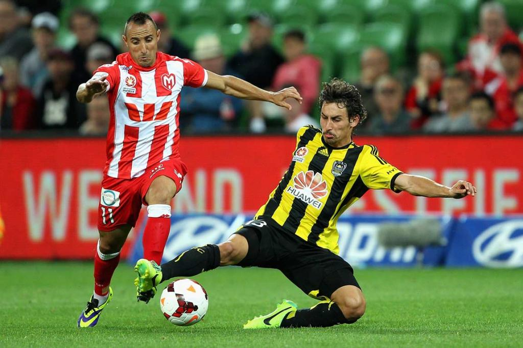 Albert Riera slides in but misses the tackle on Michael Mifsud.