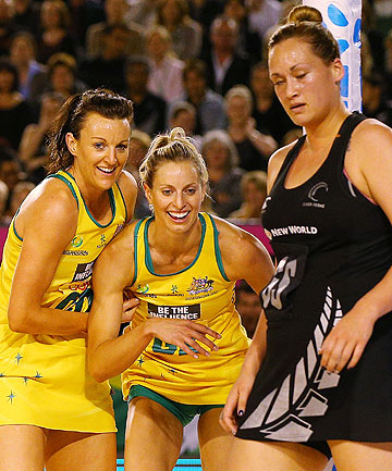 AUSSIE ANTICS: Bancia Chatfield (left) and Laura Geitz of the Diamonds react after a contest with Cathrine Latu of the Silver Ferns.
