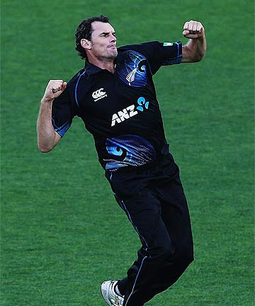 SEE YA: Kyle Mills celebrates the wicket of Narsingh Deonarine at Eden Park.
