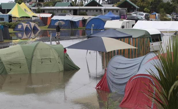 SOGGY SURPRISE: Water invades the campsite at Cooks Beach in the Coromandel.