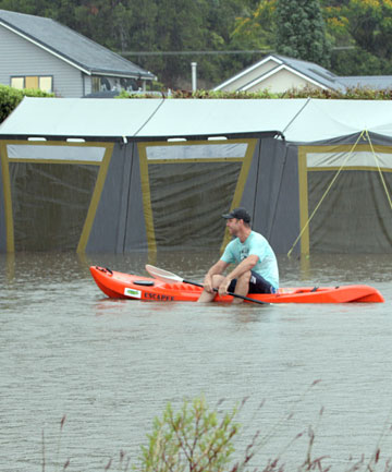 SPLISH SPLASH: This camper resorted to an alternative means of transport when the stream next to the Cooks Beach Resort flooded.