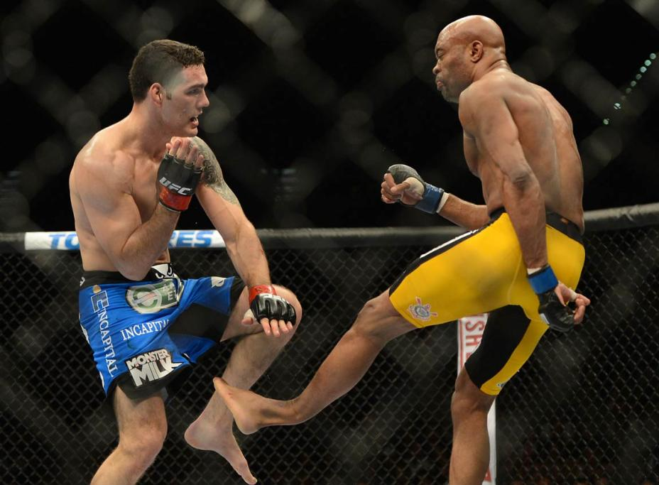Anderson Silva (blue gloves) breaks his leg on a kick to Chris Weidman (red gloves) during their UFC middleweight championship bout at the MGM Grand Garden Arena.