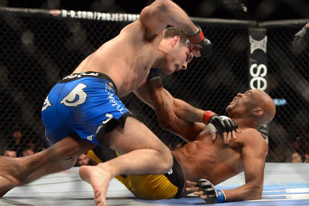 Chris Weidman (red gloves) and Anderson Silva (blue gloves) fight during their UFC middleweight championship bout at the MGM Grand Garden Arena.