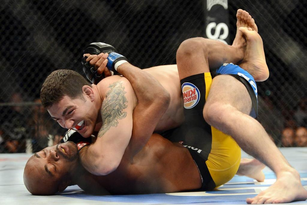 <font color=#cc0000><b>WARNING: Gallery contains graphic images that may disturb. </b> </font color=#cc0000>Chris Weidman (red gloves) and Anderson Silva (blue gloves) fight during their UFC middleweight championship bout at the MGM Grand Garden Arena.