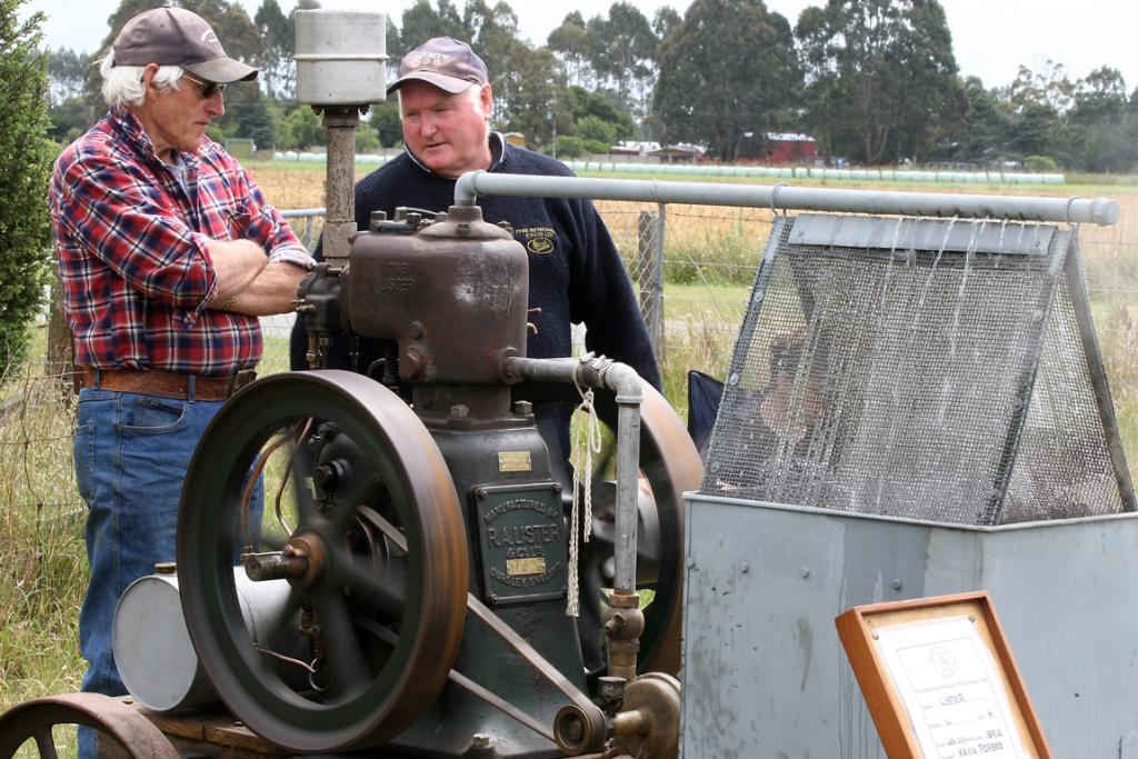 Merv Cloake, left, talks to Kevin Forbes about his Lister L 4-HP engine that previously was used in a shearing plant.