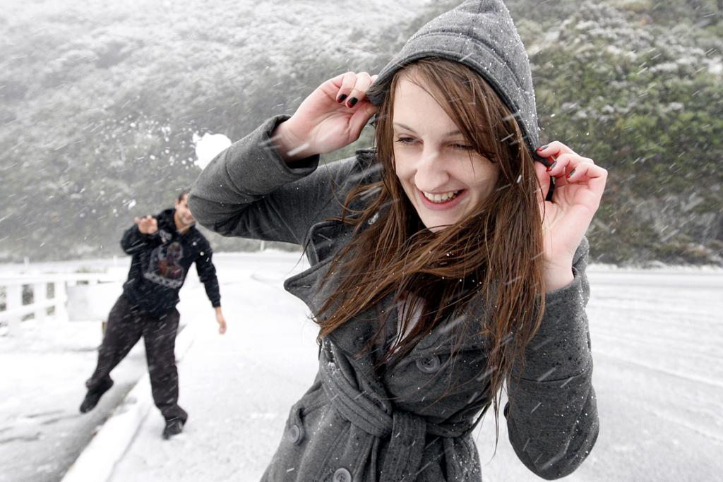Look out!: Jason Brixton and Elena Lynch from Wairarapa play in the snow on the Rimutaka Hill Rd in May.
