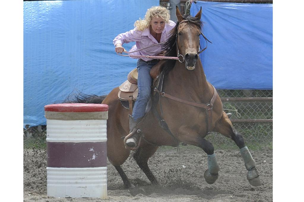Libby Bent of Christchurch is full concentration during the 2nd Div Barrel race at the 46th annual Te Anau Rodeo.
