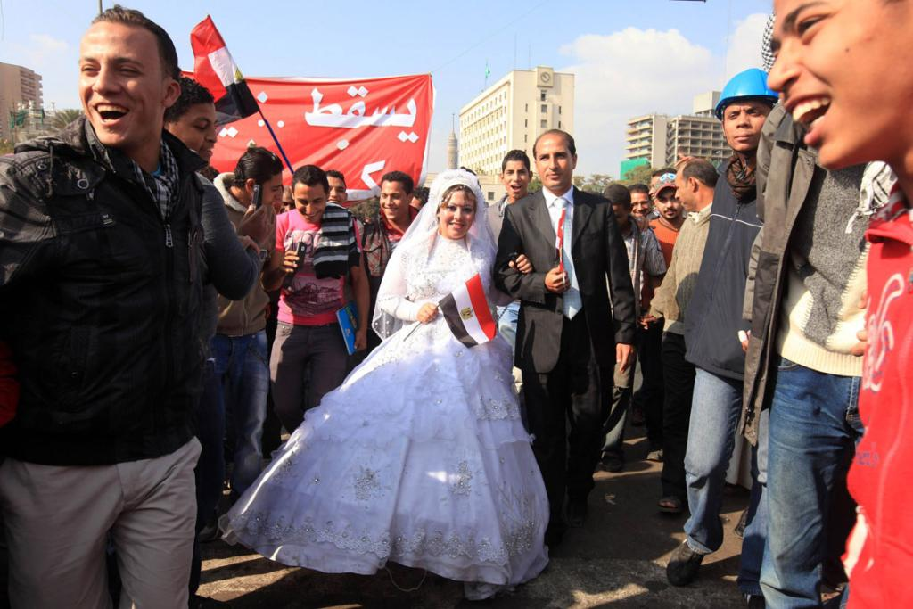 A bride and groom celebrate their wedding in Cairo's Tahrir Square, to show their support for protesters in November 2011.