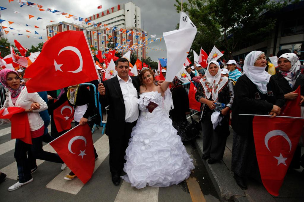 A newlywed couple joins protesters as they march towards Taksim Square in Istanbul, June 2013