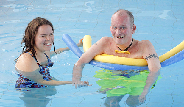 WISH COME TRUE: Frank Gocht, who has motor neuron disease, ticks off another item on his bucket list by getting personalised swim training from Paralympian Mary Fisher at Kilbirnie pool yesterday.
