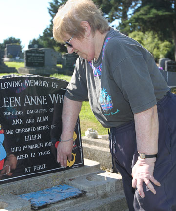 FLOWER THEFT: Flowers and their containers were taken from Ann White's daughter Colleen's grave site before Christmas.
