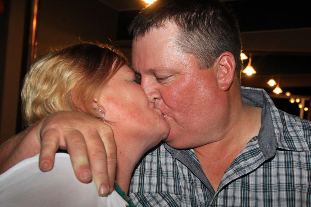 Greg and Leah Hart share a kiss to celebrate the New Year at the Gorge Road Country Club.and his 40th birthday