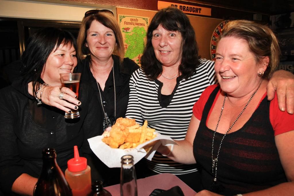 BUDDIES: Karen Mikkelsen, left, Vicki Ward and Susan Titchmarch, far right, are served by Woodlands Tavern, Invercargill. Owner Pauline Dermody (second from the right).