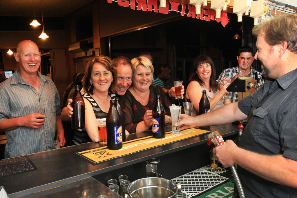 SOUTHERN ALES ON: Cor Aarts, Margot Earl, Barry Warnock, Melissa Perriam, Nicola Aarts and Brendan Payne celebrate New Year at Gorge Road Country Club, Invercargill with a few drinks from barman Rob Ashby.