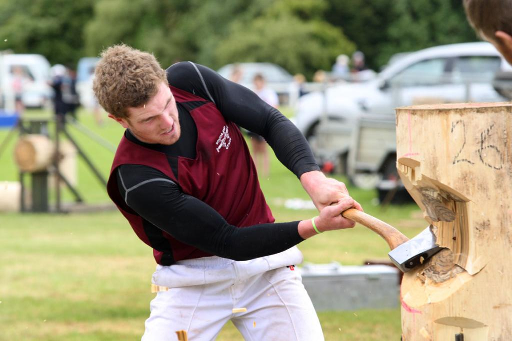 Bill Biggar competes in the butcher block in the wood chopping at the Tuatapere Sports Day on Wednesday.