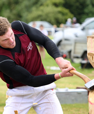Bill Biggar competes in the butcher block wood chopping competition in Tuatapere.