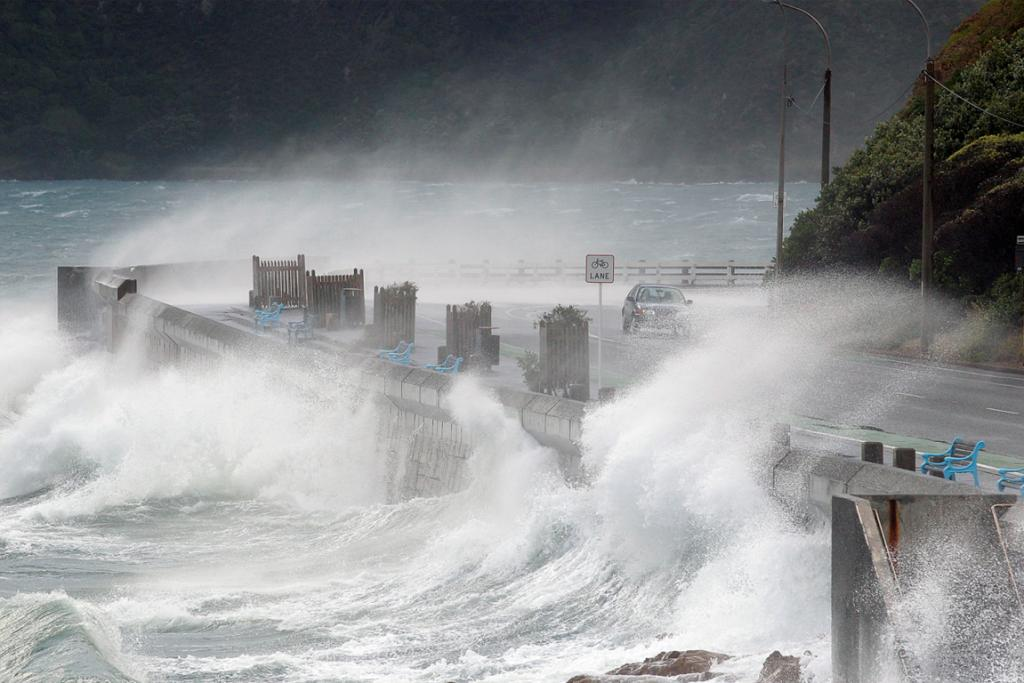 High tide and strong winds make trouble for motorists at Balaena Bay.