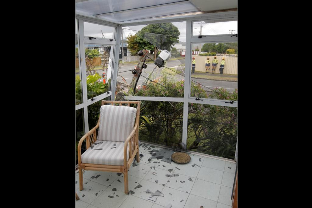 Inside Ken Oliver's conservatory after a lamp-post fell through it.
