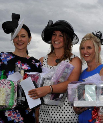 The top three placegetters in the Fashion in the Field competition at the Omakau harness meeting yesterday. From left, Sharon Cunningham (third), of Waikouaiti, Michaela Smith (winner), of Alexandra, and Angela Lacey (second), of Alexandra.
