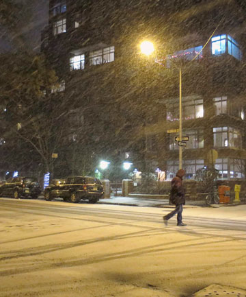 Snow starts to fall in the West Village neighbourhood of New York on Thursday evening (local time).