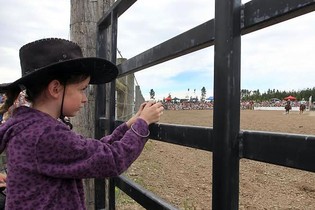 CLOSE ATTENTION: Alessandra Morrison, 11, of Kaiapoi takes photos of the action.