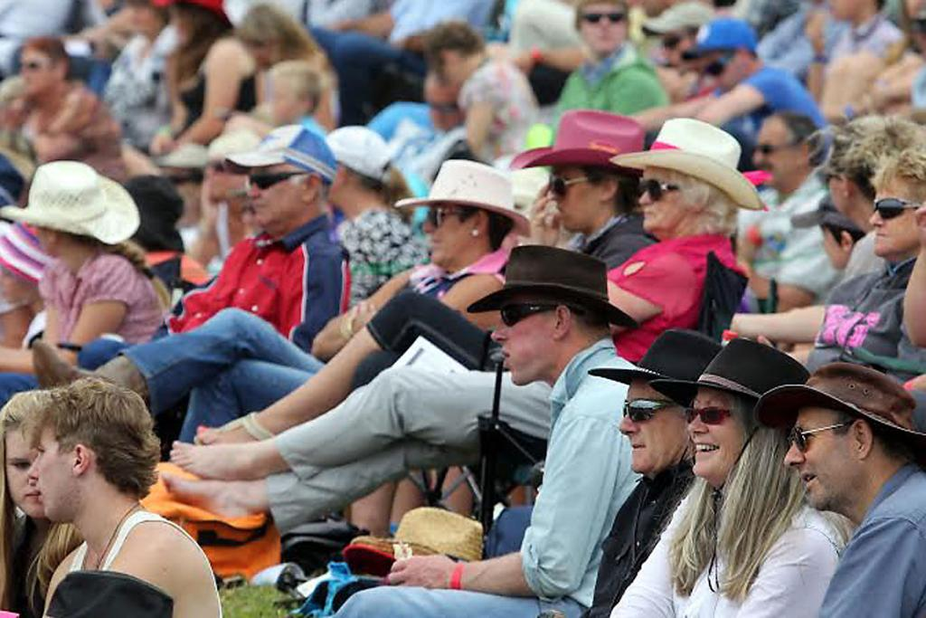 IN THE MOOD: Cowboy hats aplenty in the Mandeville crowd.