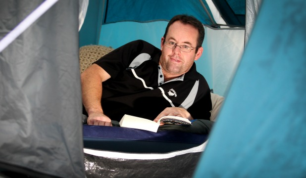 CURLED UP: Wayne Reeves finds ways to pass the time at the Fitzroy Beach Holiday Park.