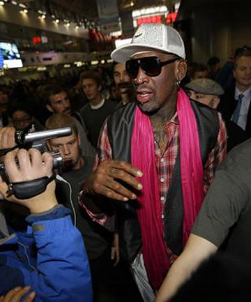 SURROUNDED: Former NBA basketball player Dennis Rodman is surrounded by journalists as he arrives at the Beijing Capital International Airport to leave for Pyongyang.