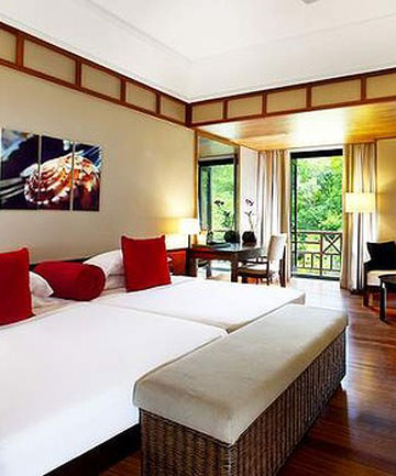 UNPARALLELED VIEWS: Rooms contain cosy beds, big windows, a balcony and a choice between a beach or rainforest view.