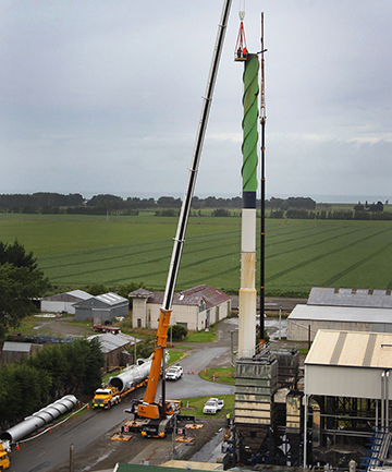 TIME TO GO: The old chimney stack is being prepared for removal at Fonterra's Studholme site.