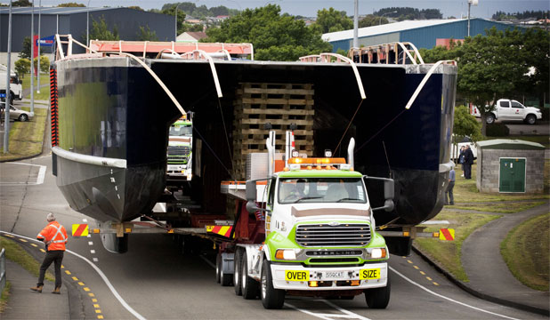 FOXTON-BOUND: The 24-metre long and 11m wide catamaran is moved out of Palmerston North.