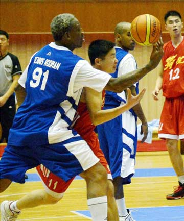 BASKETBALL DIPLOMACY: Dennis Rodman battles for possession during a game against North Korean players in Pyongyang on North Korean leader Kim Jong Un's birthday.