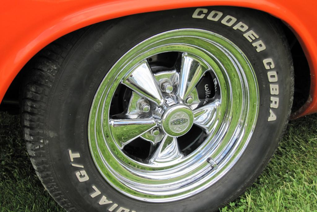 The Challanger has chrome rims, with the originals being black with a touch of orange.