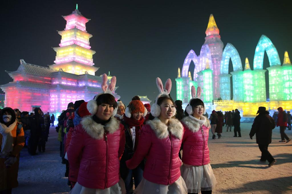 Tourists visit the ice buildings on display at the festival.