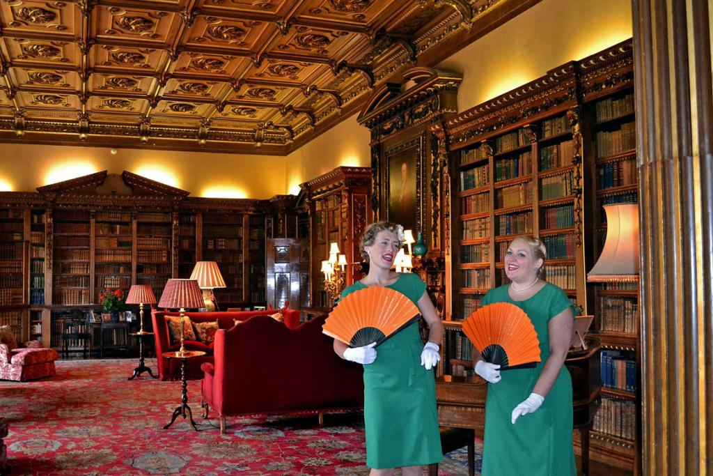 """Entertainers perform classics songs at the door to the Highclere library, where Hugh Bonneville, the fictional Earl of Grantham in the """"Downton Abbey"""" series, often has serious discussion with members of the Crawley family."""