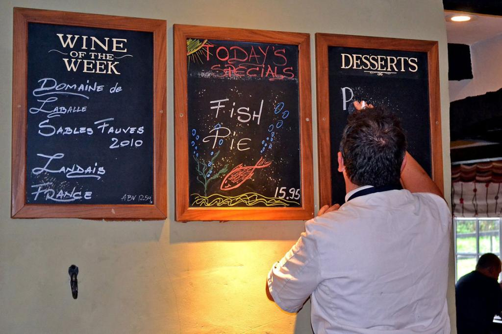 The chef writes the specials on the chalkboard at the White Hart Inn in Hamstead Marshall, England. It's about 6 miles from Highclere Castle, the stand-in for Downton Abbey.