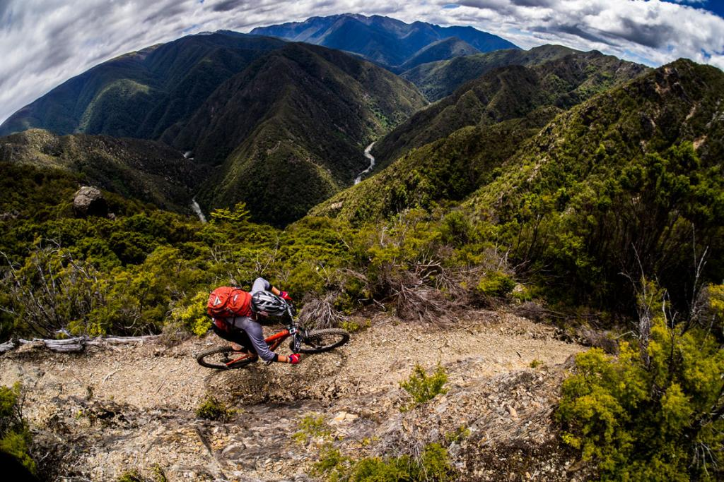 GOLDEN BAY: Anka Martin leading a Ride Housemartin trip on the Kill Devil Track in Golden Bay with the Kahurangi National Park in the background.