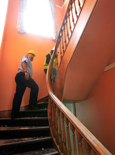 STAIRS: Inside the Lyttelton Police station, Sergeant Gary Manch walks up the staircase.