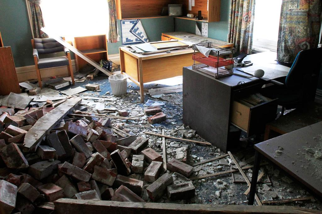 BRICKS: Brick and rubble cover an office inside the Lyttelton Police station.