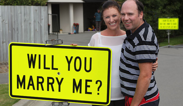 ROAD TO HAPPINESS: Ben Cook used custom-made road signs to ask his partner, Christine McNaughton, to marry him.