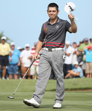 SHOOTER: Louis Oosthuizen makes eagle, then birdies the final two holes to claim the Volvo Champions title in Durban.