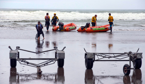 VITAL ROLE: Piha surf lifeguards head out on a rescue mission.